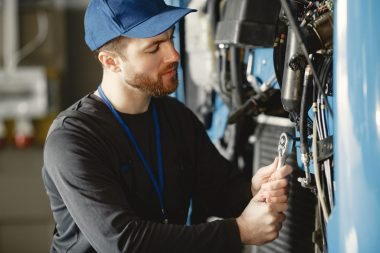ar-mechanic-repairs-blue-car-in-garage-with-tools-EWSNTPU-min