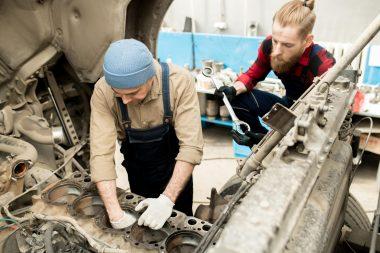 car-mechanics-repairing-truck-7RKHBJ9-min