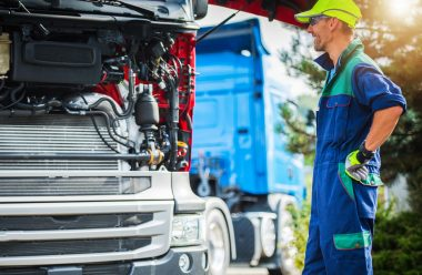 happy-smiling-professional-truck-mechanic-QURTC8V-min