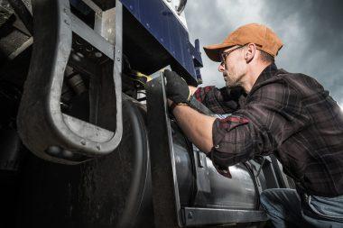 semi-truck-driver-checking-vehicle-elements-G84NLZE-min